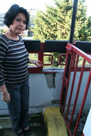 Farieda demonstrates broken masonry, which as refurbished four years ago