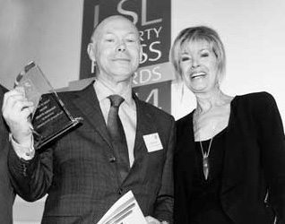 Sebastian O'Kelly receives the LSL Property Press Award for Scoop of the Year 2014 from TV presenter Julia Somerville