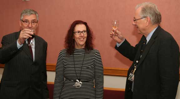 Jim Fitzpatrick (left) and Sir Peter Bottomley (right) raise glasses to toast the achievements of civil servant Paula Hassall